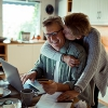 Couple at kitchen table working on paying off their credit card debt.