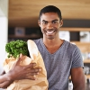 photo of a happy man with groceries and dental benefits