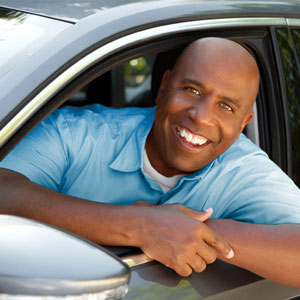 photo of a happy man with his refinanced Auto Loan