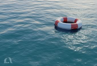 Photo of a life preserver floating in the water.